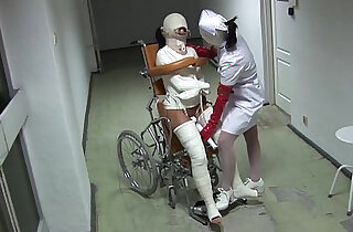Patient in Wheelchair with Legs and Straitjacket