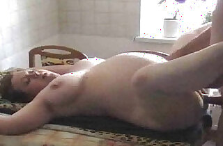Shaved pregnant slut wife getting fucked in the kitchen
