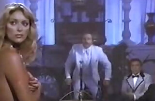 Forced blonde woman doing a striptease