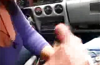 Sexy wife jerking and sucking a huge cock in a car